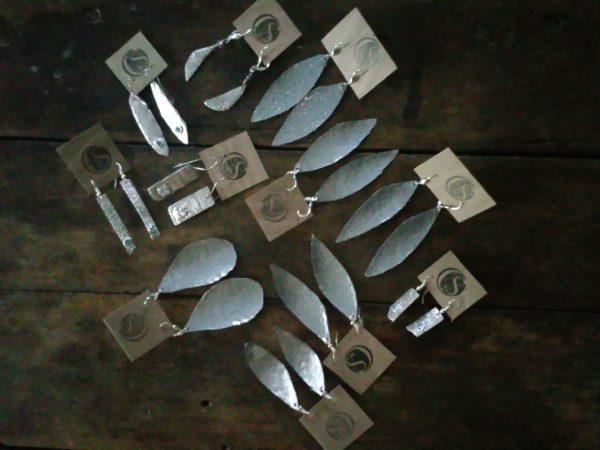 grouping of metal earrings
