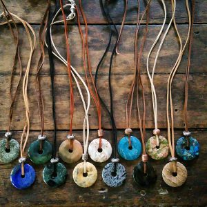 natural stone disc on leather or suede adjustable necklace.